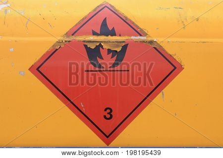 Warning Sign On Vehicle With Tank For Flammable Liquid