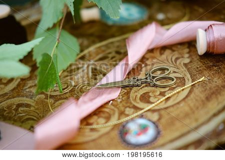 Different antique and modern decoration pieces with ribbons and treads