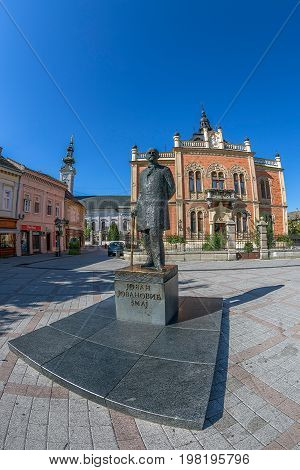NOVI SAD SERBIA - JULY 30 2017: Vladicin court in the center of city of Novi Sad residential palace of the Serbian Orthodox Bishop of the Diocese of Backa. Monument in front.