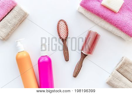 Personal care. Towels, soap and shampoo, cobs on white backgrond top view.