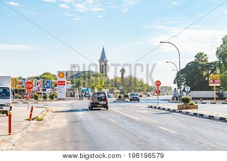 OTJIWARONGO NAMIBIA - JUNE 20 2017: A street scene with businesses and the Dutch Reformed Church in Otjiwarongo in the Otjozondjupa Region of Namibia