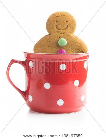 Sweet gingerbread man in cup isolated on white background. Xmas gingerbread.