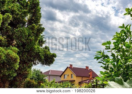 overcast sky. Wooden house building green field with house in overcast day.