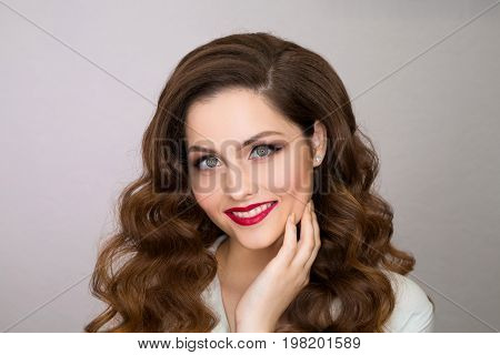 Portrait of a beautiful young girl with makeup and hairstyle