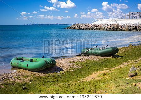 Rubber boat on the sea shore. Rubber inflatable boat for fishing