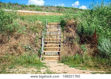 New stairway on a public beach. Stairs To The Beach