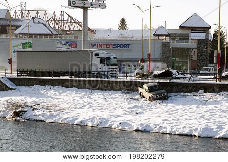 RUZOMBEROK SLOVAKIA - JANUARY 9: Car accident. Vehicle out of road in river Vah on January 9 2017 in Ruzomberok