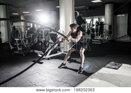 Strong Men With Battle Rope Battle Ropes Exercise In The Fitness Gym. Crossfit.