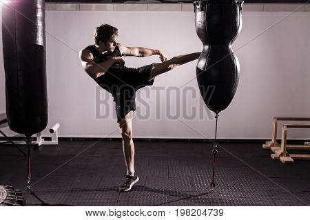 Boxer With Punch Bag In Action - A Man With A Tattoo In Red Boxing Gloves - Boxing