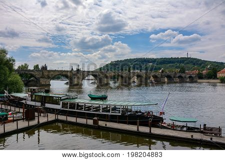 Pier at the Vltava river with a view of the Charles Bridge, Prague, Czech Republic