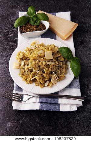 Farfalle Pasta Bows With Pesto On A Plate On A Rustic Background