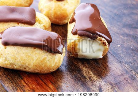 Traditional French Dessert. Eclair With Chocolate Icing. Pastery Concept