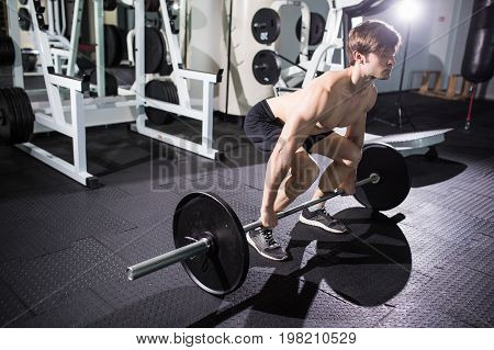 Confident Muscular Man Training Squats With Barbells Over Head. Closeup Portrait Of Professional Man