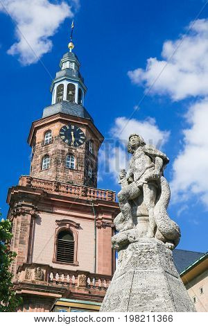 Statue of Siegfried and the Holy Trinity Church the largest Protestant church in Worms Germany. poster