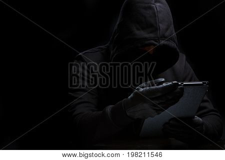 Photo of thief in black