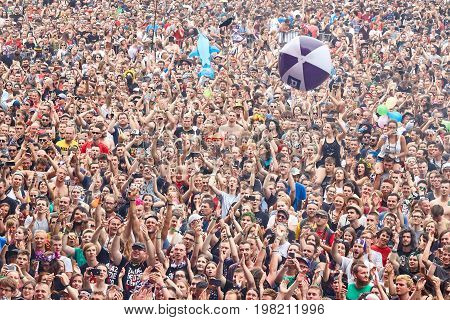Kostrzyn Poland - August 03 2017: Applauding crowd at the 23rd Woodstock Festival Poland opening ceremony. Festival is among the biggest open air festivals in the world.