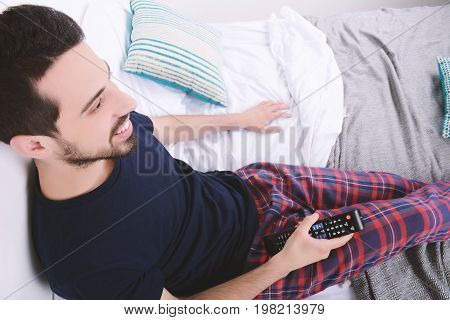 Man Watching Tv On Bed.