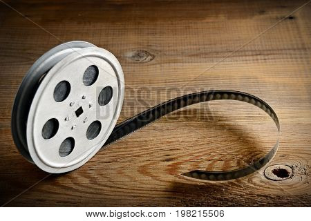 Old film strip on wooden background. Top view. Copy space.
