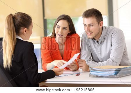 Customers Solving Doubts About Contract At Office