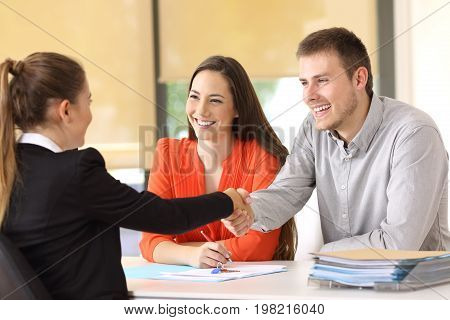Happy Customers Handshaking After A Deal