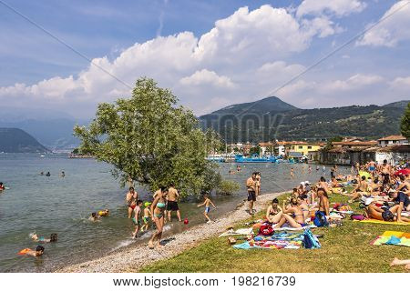 Crowded Beach On Iseo Lake, Lombardy, Italy