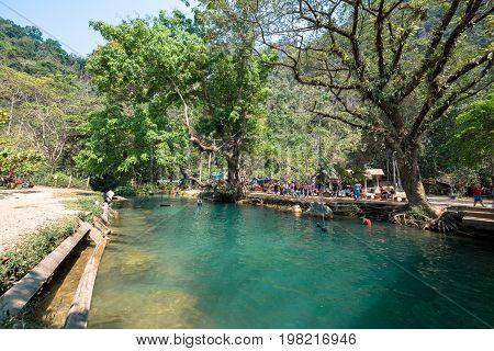 VANG VIENG LAOS - MARCH 14 2017: Horizontal picture of sunny day in the beautiful Blue Lagoon located close to the city of Vang Vieng Laos.