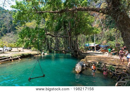 VANG VIENG LAOS - MARCH 14 2017: Horizontal picture of amazing sunny day in Blue Lagoon located close to the city of Vang Vieng Laos.