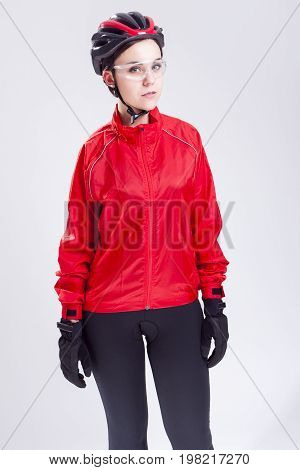Sport Concepts and Ideas. Portrait of Caucasian Female Cycling Athlete Posing Equipped in Professional Outfit in Studio.Vertical Image Composition
