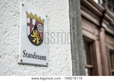 Metal Sign mounted to wall with the German word Standesamt translation register office emblem of the german Region Rhineland Palatino