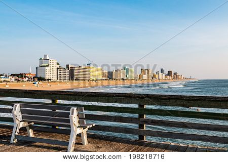 VIRGINIA BEACH, VIRGINIA - JULY 13, 2017:  View from the fishing pier of the high-rise hotels lining the boardwalk along the oceanfront.