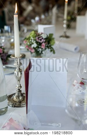 Dinner table set wine glas candle burning Wedding menu card Event detail Copyspace to fill