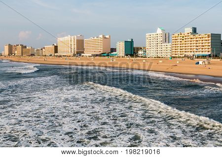 VIRGINIA BEACH, VIRGINIA - JULY 13, 2017:  Day breaks on the oceantfront hotels lining the boardwalk at this popular summer tourist destination.