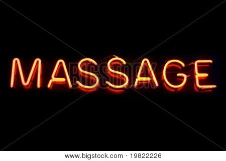 Red neon sign of the word 'Massage' on a black background.