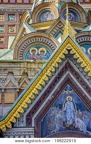 Facade details of Savior on the Spilled Blood cathedral with its golden domes and characteristic architecture in St. Petersburg Russia