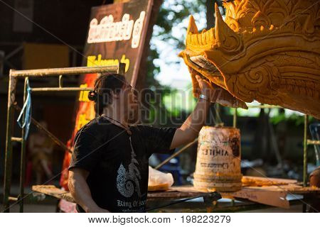 Craftsman fix the candle on the candle float for candle festival in Ubon Ratchathani, Thailand on June 08, 2017.