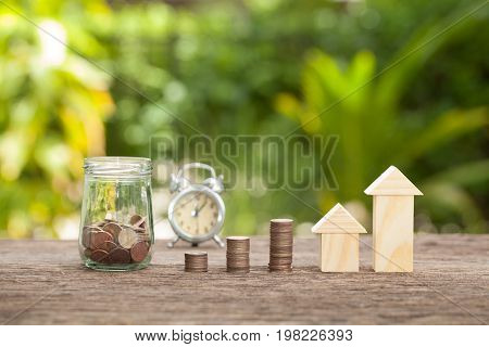 Time to save coins in money jar. Concept of real estate investments Home insurance Savings plans for housing. The concept of financial savings to buy a house.
