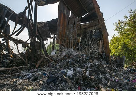 Huge heap of metal and plastic rubbish, beam and overlapping left after the fire the building burned to the ground