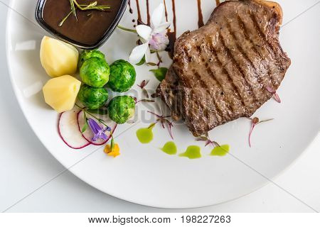 Grilled Pork with Brussels Sprouts and Vegetables.