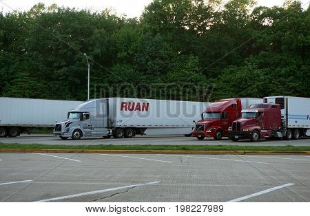 MICHIGAN CITY, INDIANA / UNITED STATES - MAY 31, 2017: Trucks are parked at the Michigan City Welcome Center on Interstate Highway 94.