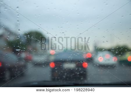 Traffic jams in the city - rush hour. Rainy season softfocus and over blurry