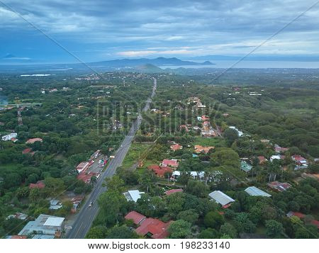 Road going to Managua city in NIcaragua. Highway on central america landscape aerial view