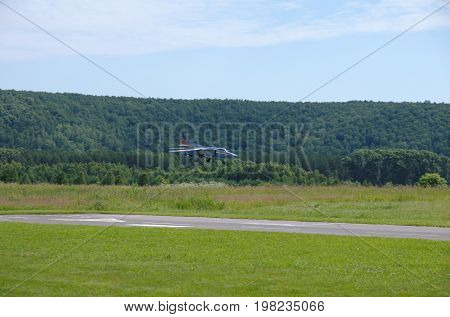 PENZA OBLAST, RUSSIA - JULY 15, 2017: Radio control flying model of MiG-23 aircraft landing. The Russian Aeromodelling Cup in Bolshoy Vyas village.