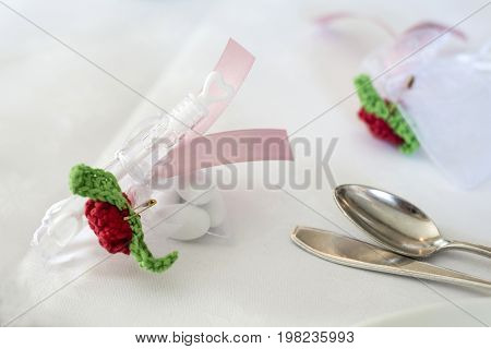 Wedding guest present gift with soap bubbles maker on the table with candy for wedding ceremony
