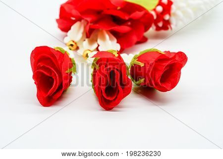 Closed Up Fabric Red Rose On Thai Plastic Garland Isolated On White