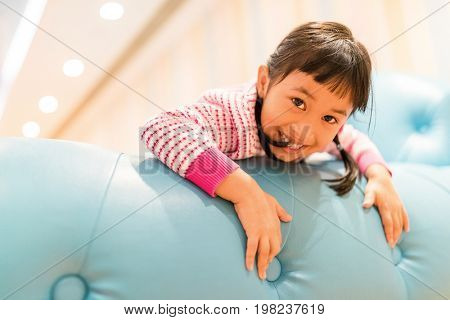 Asian kids play at home