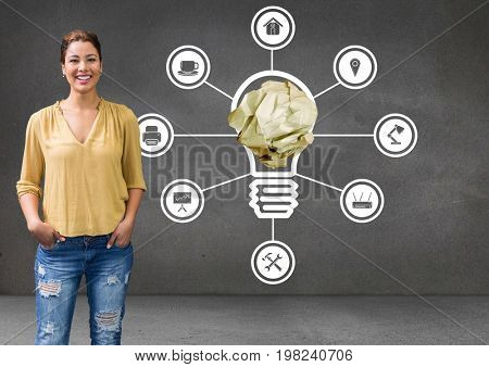 Digital composite of Woman standing next to light bulb with crumpled paper ball and connections