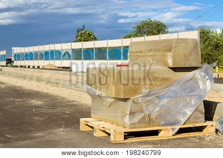 Concrete curbs. Construction of high-speed bypass road around Krasnoe Selo Saint Petersburg. Excavation works at civil industrial construction. Russia
