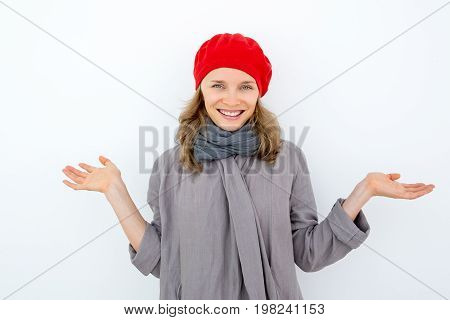 Smiling misunderstanding woman shrugging shoulders and looking at camera. Playful young French woman gesturing as symbol of incomprehension. Unaware concept