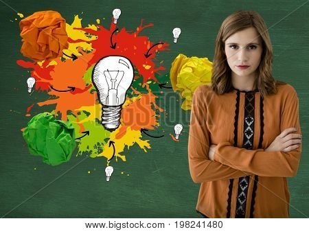 Digital composite of Woman standing ext to light bulb with colorful crumpled paper balls in front of blackboard