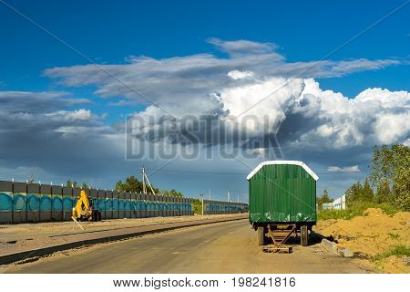 Working shed trailer for workers. Construction of high-speed bypass road around Krasnoe Selo Saint Petersburg. Heavy machine equipment for excavation works at civil industrial construction. Russia